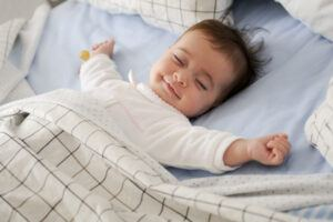 Smiling sleeping baby that is possible dreaming